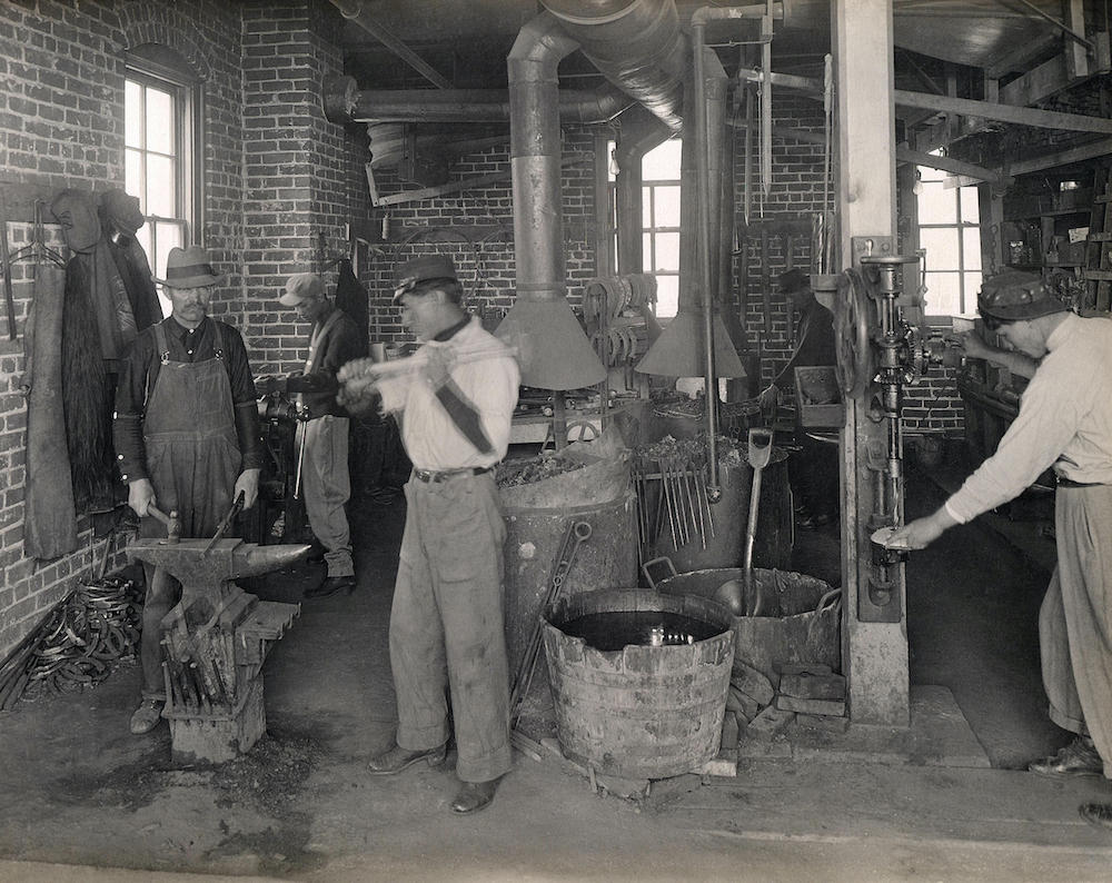 Iron working department in blacksmith and wagon shop.